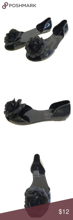 Black Jelly Flats with silk floral accents. Steven by Steve Madden have taken Jellies to new heights! Cute and very comfy flats accented with pretty silk flower are a great accessory for any outfit. Slightly used. Steven by Steve Madden Shoes Flats & Loafers