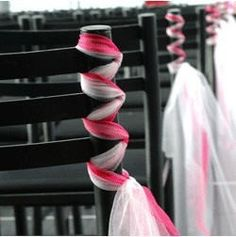 I am in love with these chair decorations!  Braid some tulle in your wedding colors around the sides of the aisle chairs and walk down the aisle surrounded by bright, creative decorations.  Also, a very cheap substitution to those expensive traditional flowers.