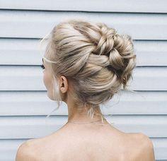 Intricate high bun by Sybella