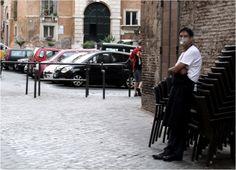 An Indian waitress outside a Jewish restaurant take a break