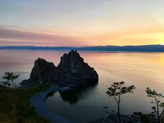 Siberian sunset over Shaman Rock on Olkhon Island Lake Baikal Russia    Click on the photo to discover the most incredible destinations with us :)