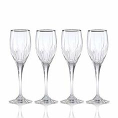 Mikasa Arctic Lights Platinum Crystal Wine Glasses, Set of 4 by Mikasa. $119.99. The elegance of the platinum rim only enhances the intricate cuts and exuberant curves of this luxurious stem ... ready to elevate your tablesetting to new heights as it captivates your guests with its charm. This crystal pattern coordinates perfectly with formal dinnerware and flatware. Dishwasher safe - top rack. Set of 4 crystal wine glasses, each holds 6 ounces.