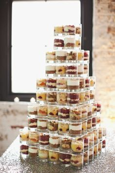Food for thought(pun intended): Instead of a single cake at the reception, how about a mile high cake-shaped masterpiece consisting of a huge variety of miniature cakes-in-a-cup(or whatever these are called). I'm not too keen on having my wedding be cake-less, but I'm digging the outside-the-box idea. Yum!