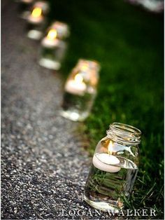 Mason jars with floating candles line the pathway to the backyard reception. - - Mason jars with floating candles line the pathway to the backyard reception. Mason jars with floating candles line the pathway to the backyard reception. Deco Champetre, Backyard Bbq, Wedding Backyard, Backyard Ideas, Garden Wedding Ideas On A Budget, Garden Ideas, Wedding Ideas Do It Yourself, Weddings On A Budget, Backyard Movie
