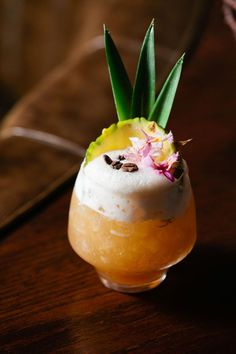 10 Tiki Cocktails for a Tropical Getaway at Home -tiki swizzle, not so blue Hawaii