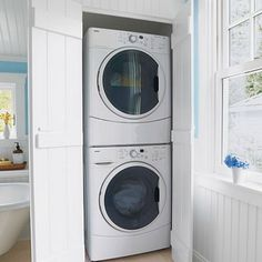 This duo is stacked in a bathroom laundry closet.  I love the shutter-style board and batten doors.  Remember to make the closet opening larger than the width of the washer and dryer, so they can be removed without taking off the doors.