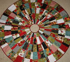 I bought fabric today to make a tree skirt similar to this one!