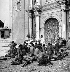 US soldiers kneel during outdoor Mass being conducted by a Filipino priest in front St. Augustin, Manila's oldest Catholic church during a lull in the battle for the city, 25 February 1945 Old Catholic Church, Catholic Priest, Roman Catholic, Philippines Culture, Manila Philippines, History Magazine, American Soldiers, Historical Photos, World War Ii
