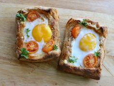 The ultimate breakfast tart: buttery crisp blitz puff pastry and melted cheese form a decadent base for a gently cooked egg and roasted tomatoes.