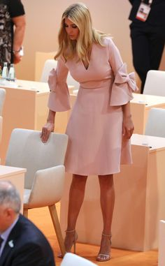 Ivanka Trump takes her seat at the beginning of the third working session of the meeting. Pale pink blush dress with bow detail on sleeves, high heels. Ivanka Trump Outfits, Ivanka Trump Style, Ivanka Trump Dress, Classy Dress, Classy Outfits, Look Fashion, Fashion Outfits, Blush Pink Dresses, African Fashion Dresses