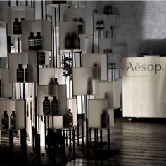 idee display clear resin boxes on steel rods Aesop at I.T Hysan One by Cheungvogl