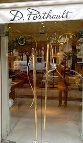 PLEASURE OF THE BEST Golden needle and thread door handles At D. Porthault, Paris for luxe bed linen