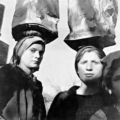 Credit: Women carrying mud, Epirus, c.1945 (b/w photo), Papaioannou, Voula (1898-1989) / Benaki Museum, Athens, Greece / The Bridgeman Art Library