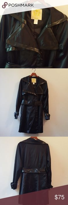 """High Fashion Leather Trimmed Short Trench Coat Lovely and striking matte black short trench coat with collar and lapel edged with black vegan leather as well as belt and  buckle cuffs. Fabric lined hidden double breasted snaps. Polyester satin inner lining. 35"""" flat length approximately. Wet Seal Jackets & Coats"""