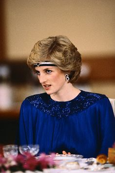 Princess Diana wears earrings made from the Saudi Sapphire and Diamond Suite watch,  and a headband made from the suite's bracelet, to Emperor Hirohito's banquet.