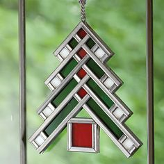 """Art Glass Tree Ornament. Exquisitely crafted art glass to adorn a holiday tree or catch the light in any window year-round. 4-1/2""""w x 5""""h. $45"""
