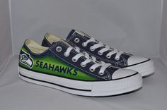 These are custom-made, hand painted on official navy blue converse all-star low-top shoes. They are made to order and may take up to 2-4 weeks. If you need them done sooner you may leave me a message and I will do my best accomodate your needs. Each shoe has the seahawk on opposites sides. This is particular design is for women and it has a layer of glitter.  I use high quality acrylic paint (and silver glitter paint as well) with a double-layer of high-quaility glossy varnish to seal…
