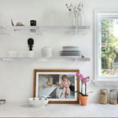 lucite floating shelves, artwork