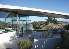 This island holiday home by Lund Hagem is sheltered beneath a wide concrete canopy, which bridges surrounding rock formations to frame views to the coast Canopy Bedroom, Door Canopy, Canopy Tent, Ikea Canopy, Beach Canopy, Fabric Canopy, Backyard Canopy, Garden Canopy, Interiors