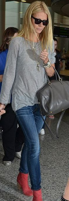 Who made Gwyneth Paltrow's gray leather handbag, red suede boots, black sunglasses, and skinny blue jeans?