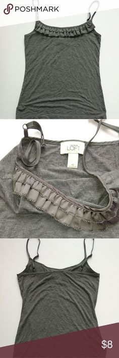 3 for $10 Ann Taylor Loft Grey Ruffle Tank Excellent like new condition. No holes, stains, flaws or signs of wear. Measurements available upon request, or if you have any other questions let me know! Spring Cleaning Sale! If item is under $10, I accept 3 items for $10, also 7 for $20 - Just bundle  items you'd like and submit an offer for $10 or $20 accordingly, I'll accept! LOFT Tops Tank Tops