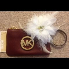 "NWT Michael Kors Fulton Leather Wristlet NWT Michael Kors Fulton Leather Wristlet.  Beautiful claret/maroon color!!!  Has the gold hardware MK logo on the front of the purse.  Measures approx 7"" in length & 4 1/2"" in height Michael Kors Bags"