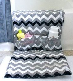 DIY Bath Mat With Pockets. Kneeling on the hard title floor while giving the kids a bath can do a number on your knees. Create the DIY Bath Mat with Pockets. This free sewing project will not only give knees a comfy place to rest, it's easy storage for bath supplies. #video   ~someone in my family better have a baby 'cause this is so awesome~