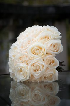 classically beautiful open cream 'vendela' roses in a hand tied bridal bouquet from pollen flowers