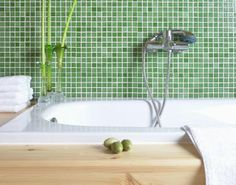 How To Decorate Your Feng Shui Money Area Bathroom: Wood element can be expressed in a variety of ways - from green colour tiles to wood surfaces and live plants. The square shape of tiles expresses the Earth element, which is also good for a bathroom in the feng shui money area.