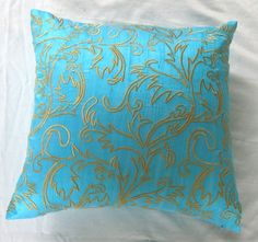 aqua blue throw pillow cover with yellow filigree feather embroidery