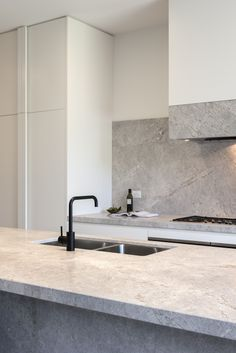 Close up of a beautiful New Savior Limestone kitchen designed by Lauren Tarrant Design.