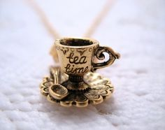 """Teacup & saucer """"Tea Time"""" charm necklace. want soo bad! dying just looking at that"""