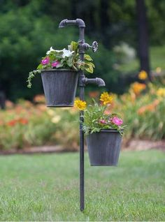 "Show off your style and add the finishing touches to your landscape with this double plant holder stake that will hold two plants at the same time. FLOWER POTS ARE INCLUDED! This piece measures 40½"" t"
