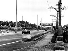 Stirling Moss, Vanwall VW10 correcting a delicate slide on the cobblestones of the Boavista Circuit, Portuguese Grand Prix 1958