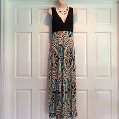 Beautiful cocktail/sun dress! Pair with heels and wear to a cocktail party or pair with flat sandals for a great vacation night look.  This dress is stunning.  Made of Polyester and Spandex.  Very soft.  Worn once. XOXO Dresses Maxi
