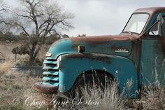 1952 Chevrolet pickup truck.  It sits on a highway in northern New Mexico.  Love the teal blue color.