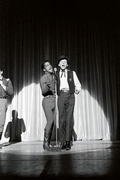 """""""There was a charity that the Rat Pack all supported called SHARE, a showbiz charity for underprivileged kids. Every year they had a big western-themed gala party at a nightclub in Los Angeles. So you have images of all the Rat Pack up on stage dressed as cowboys but they're alongside John Wayne and Randolph Scott, all the great cowboy actors, Louis Jordan and various singers..."""" Old Hollywood Stars, Hooray For Hollywood, Rat Pack Party, Joey Bishop, Randolph Scott, Sammy Davis Jr, Music Happy, Shirley Maclaine, Recent Movies"""