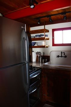 For a tiny kitchen this had it all, full size fridge, stove, trash compactor, and plenty of storage with a pantry.
