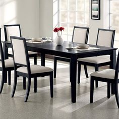Add a classic touch to your living room or den with this lovely wood-framed dining table, showcasing a sleek silhouette and black finish.  ...