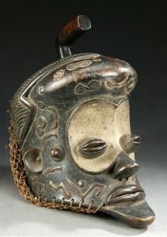 Africa | Helmet mask from the Luba people of DR Congo | Wood, pigment and raffia knotted headdress.