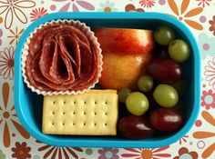 salami, crackers, grapes and apple chunks