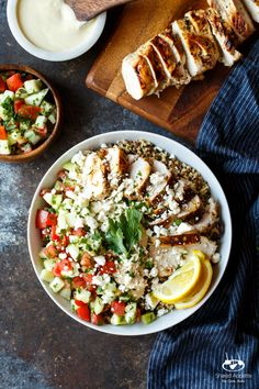 Mediterranean Chicken Quinoa Bowls with Israeli Salad, Hummus, and Tahini Sauce | sharedappetite.com