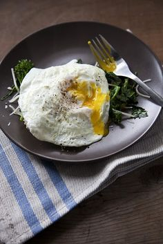 Yummy breakfast-- eggs over easy on top of a bed of cooked spinach with mozzarella cheese