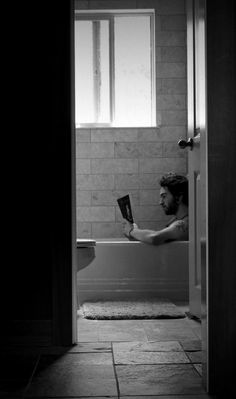Reading and relaxing in the tub