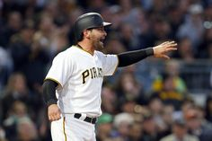 Francisco Cervelli Photos Photos - Francisco Cervelli #29 of the Pittsburgh Pirates reacts after scoring on a throwing error in the second inning against the Atlanta Braves at PNC Park on April 8, 2017 in Pittsburgh, Pennsylvania. - Atlanta Braves v Pittsburgh Pirates
