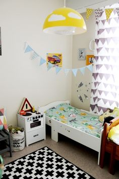 Kids room, little boys bed.