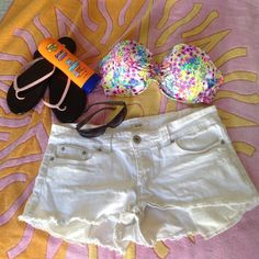 """BOGO SALE White denim shorts """"Short"""" shorts really show off your legs! Grab a tan at the beach with these low in front shorts. All Cotton with a bit of Spandex (1%) for comfort. White goes with everything! Forever 21 Shorts Jean Shorts"""