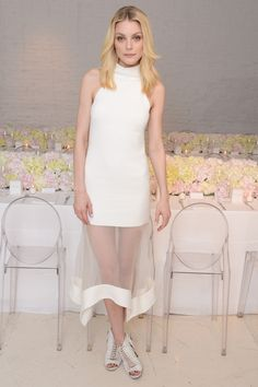 Who: Jessica Stam What: A '90s Silhouette Why: The white dress is always in summer-season, but Stam's Camilla and Marc dress, which she wore to host the dinner for the launch of their Resort collection, melds a mock turtleneck and sheer details to chic effect. Get the look now: Camilla and Marc dress, $599, camillaandmarc.com.   - HarpersBAZAAR.com