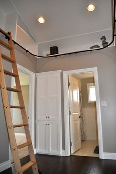 Built in bookshelves with library ladder - by Rafterhouse.