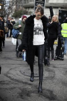 Behati Prinsloo's Street Fashion: Black fur coat with a tee, black leather pants and black boots, finished off with messy bun and aviators. Fur Coat Outfit, Leather Pants Outfit, Black Leather Pants, Leather Leggings, Black Boots, Looks Street Style, Autumn Street Style, Street Chic, Look Fashion
